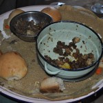 Goat & goat intestines with injera bread