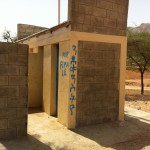 Red cross toilets in the village - made possible with water tanks provided by the trust