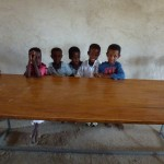 Village children test-drive the new library study benches