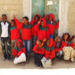 Children modelling their KitAid hoodies